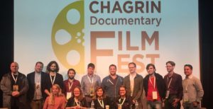 Documentary filmmakers including Noemi Veronika Szakonyi and Mate Artur Vincze pose for a family photo at the Chagrin Film Festival