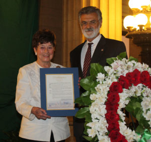 Jenny Brown and Cleveland Mayor Frank Jackson presenting a proclamation on the Revolution's Anniversary